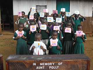 Compassion CBO Chidren form words In Memory of Aunt Polly